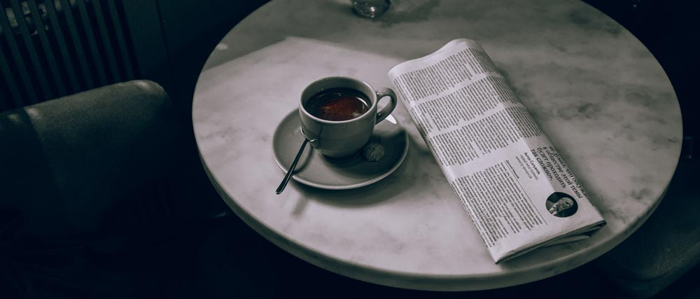 Tea cup with news paper